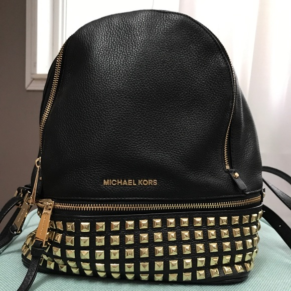 ab6f51910be2 Rhea Medium Studded Leather Backpack. M_5aa03c419a94556de08feb4b. Other  Bags you may like. Michael Kors ...